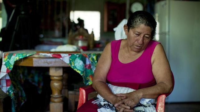 Mr Alvarenga's mother, Maria Julia Alvarenga, waits for a TV interview at her house in Garita Palmera