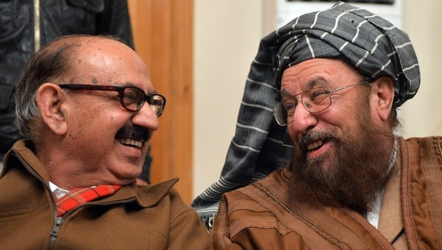 Tehreek-e-Taliban Pakistan committee member and senior religious party leader Maulana Sami-ul-Haq (R) and Special Assistant to Pakistan's prime minister Irfan Siddiqui smile prior to a joint press conference following their meeting at the Khyber Pakhtunkh