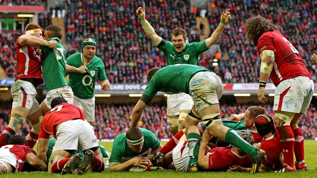 Brian O'Driscoll scores Ireland's third try against Wales last year