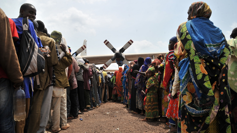 People fleeing inter-religious violence in Central African Republic wait at the Bangui air force base for their evacuation to Chad