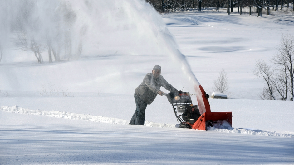 Manny Gonzalez clears a path through the snow at the William J Devine Golf Course in Roxbury, Massachusetts