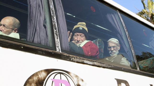 Relieved evacuees being bussed out of Homs