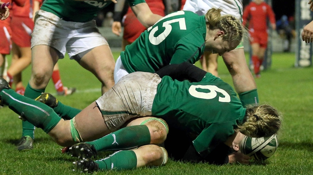 Heather O'Brien of Ireland is mobbed by team-mates after scoring