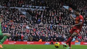 Raheem Sterling scoring in Liverpool's rout of Arsenal last season
