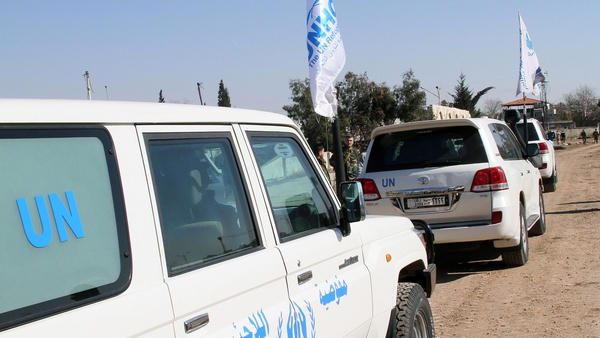 United Nations (UN) vehicles parked before bringing in aid to civilians in the rebel-held areas of the Syrian city of Homs