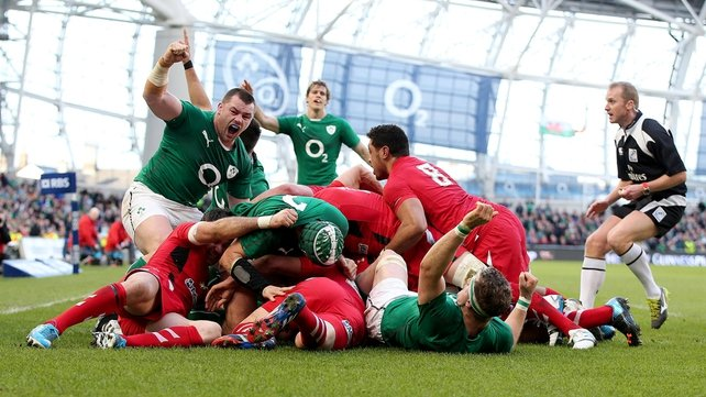 Cian Healy celebrates Chris Henry's try against Wales