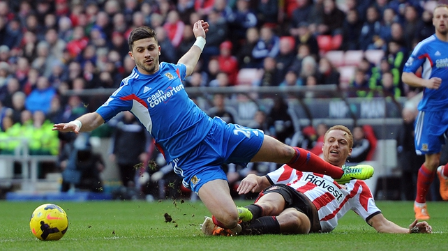 Wes Brown of Sunderland was red-carded for chopping down Hull's Shane Long