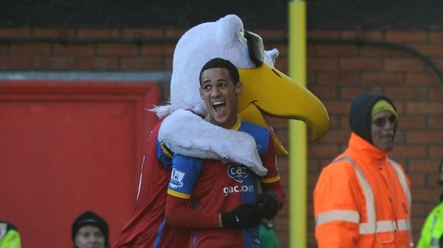 Palace's Tom Ince celebrates with the Eagles' mascot after scoring on his home debut
