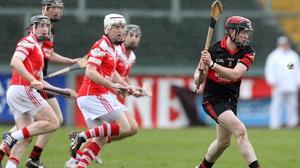 Mount Leinster's Derek Byrne gets his shot off