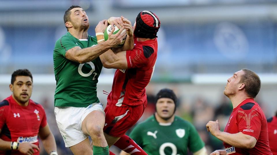 Full-backs fly: Rob Kearney and Leigh Halfpenny hang on for dear life