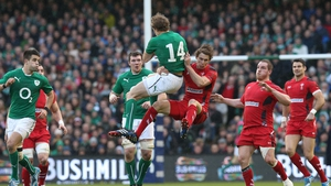 Hang-time: Andrew Trimble and Liam Williams leap for the ball