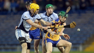 Conor O'Hare of Portumna with David Breen and Shane Dowling of Na Piarsaigh