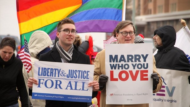 Spencer Geiger (left) and Carl Johansen protest for equal marriage outside the Walter E. Hoffman US Courthouse in Norfolk, Virginia