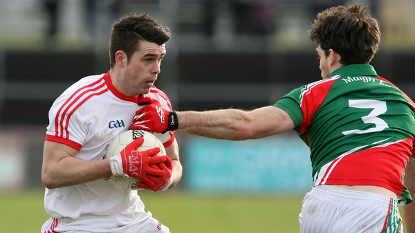 Darren McCurry of Tyrone and Ger Cafferkey of Mayo