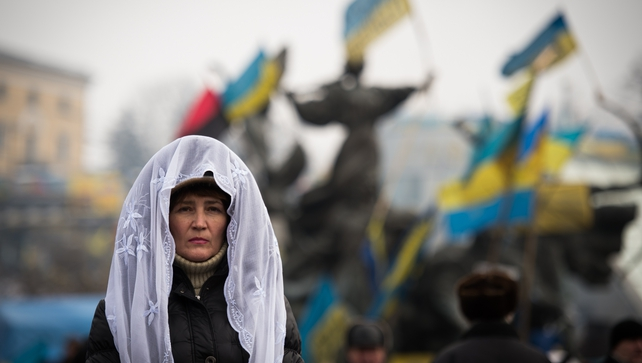 A woman attends a mass rally of the opposition on Independence Square in Kiev