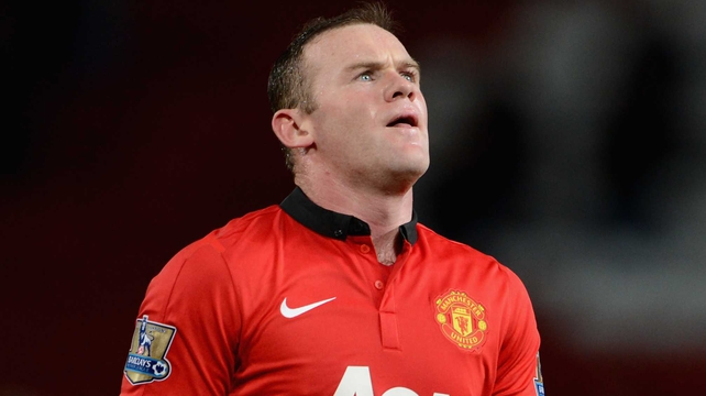 Wayne Rooney is dejected after the game