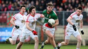 Seán Cavanagh in pursuit of Aidan O'Shea in Healy Park