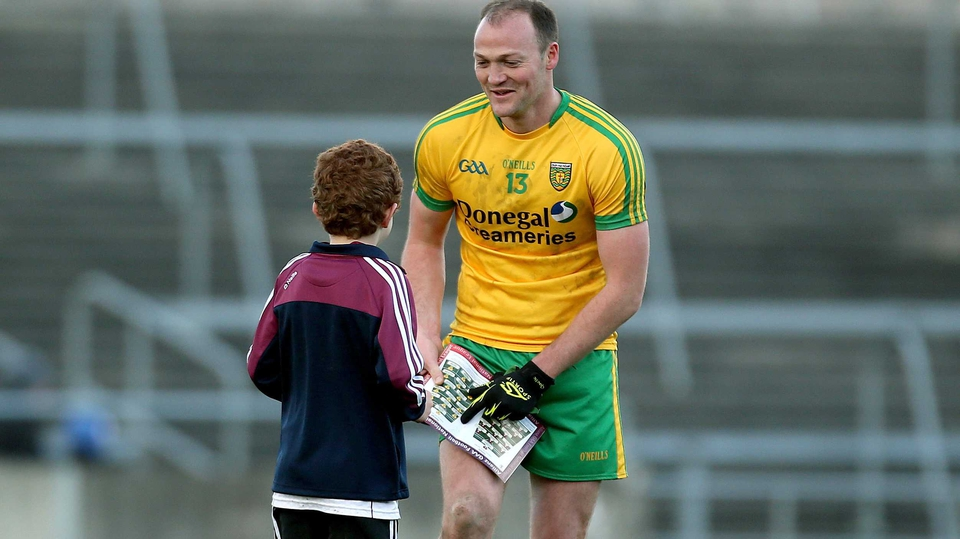 Donegal's Colm McFadden signs an autograph for a Galway fan