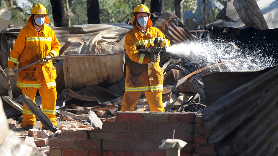 Firefighters at the scene of a blaze after a bushfire took out at least three homes in Warrandyte