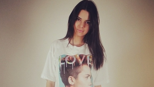 Kendall Jenner poses in her Miley Cyrus t-shirt