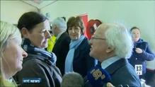 President Higgins visits flood victims in Limerick and Cork