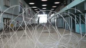 Barbed wire covers the entrance to the main hall