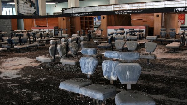 Bird droppings cover seats in a waiting room inside the old Nicosia airport terminal building