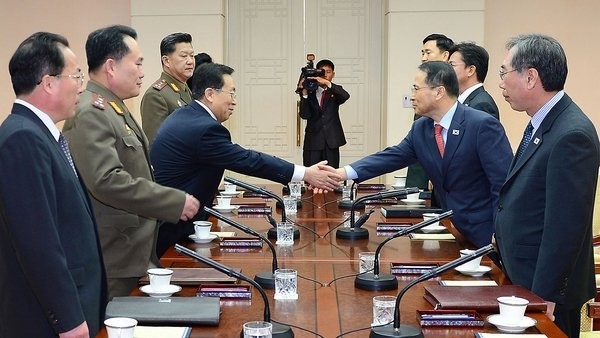 Representatives of both sides shake hands before the talks in Panmunjom (Pic: EPA)