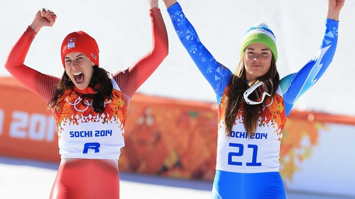 Dominique Gisin and Slovenia's Tina Maze could not be separated and shared gold in the downhill event