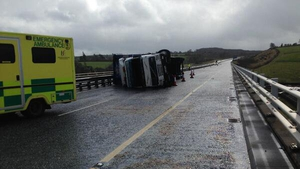 Gardaí tweeted a picture of a truck overturned due to high winds on the M8 at Fermoy