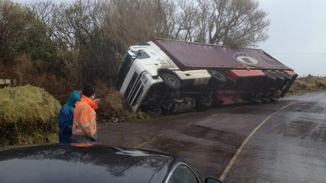 A lorry was lifted and blown on its side by severe gusts in west Kerry
