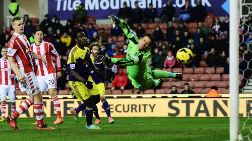 Asmir Begovic is unable to stop Chico Flores' effort