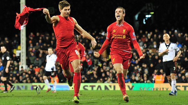 Steven Gerrard (l) celebrates his late winner against Fulham