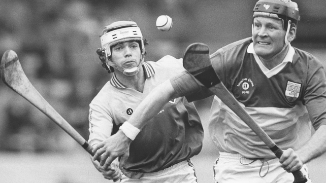 Wexford's Sean Flood and Joachim Kelly (r) of Offaly pictured in the 1991 NHL final