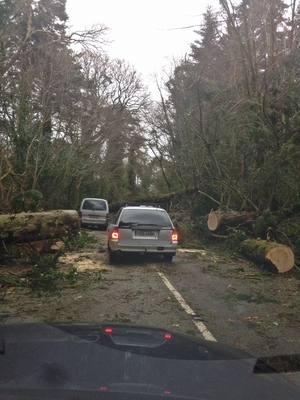 Cars pick their way through storm debris in Kenmare, Co Kerry (Pic: David Mossy)