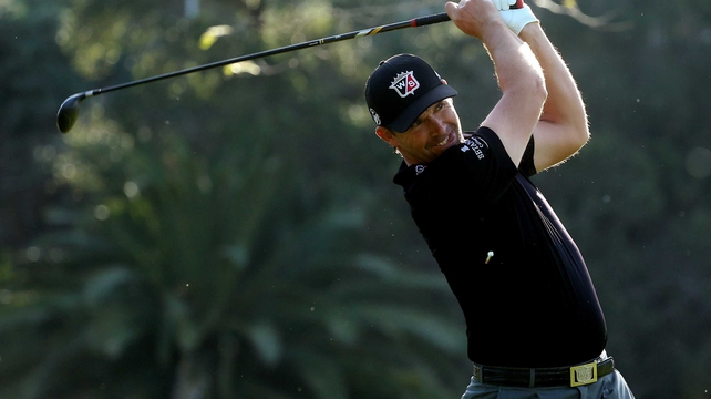 Padraig Harrington is nine strokes behind leader Dustin Johnson