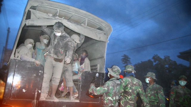 Soldiers evacuate ash covered residents after Mount Kelud erupted last night