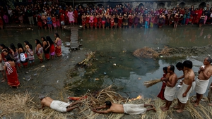 Hindu devotees roll on the ground before taking a holy bath in the Hanumante river during the final day of the month long Madhav Narayan fasting festival, in Bhaktapur, on the outskirts of Kathmandu, Nepal (Pic: EPA)