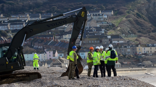 David Cameron (fourth from right) visits Chesil Beach, where flood defence repairs are under way (Pic: EPA)