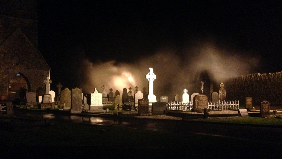 Waves crash against the wall of the Abbeyside churchyard in Co Waterford (Pic: Patrick Kenealy)