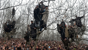 Kashmiri villagers shout pro-freedom slogans during the funeral of alleged Hizbul Mujahideen militant Arshid Ahmed in Shopian