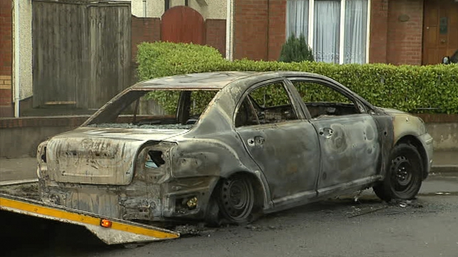 A burnt out car was removed from the scene at Earlsfort Estate this morning