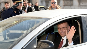 Enrico Letta waves as he arrives at Quirinale palace in Rome to formally submit his resignation
