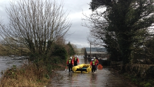 Fire service personnel from Loughrea carrying out a water rescue at Grannagh, near Peterswell, Co Galway