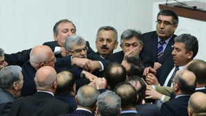 Members of the Turkish parliament scuffle during a debate in Ankara. The draft law will give the government tighter control over the appointment of judges and prosecutors.