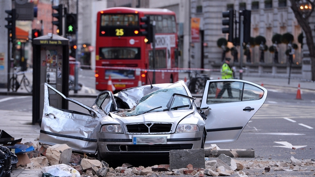 A woman was killed when part of a building collapsed on to a car in London (Pic: EPA)