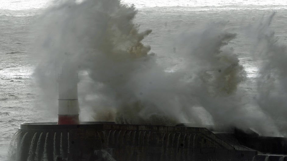 Rough seas pound Newhaven harbour on England's south coast (Pic: EPA)