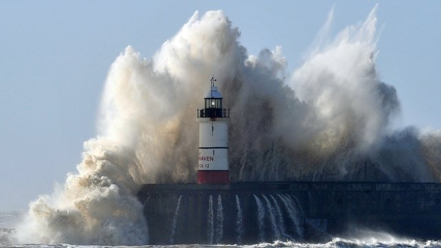 Huge waves crash over the pier wall in Newhaven