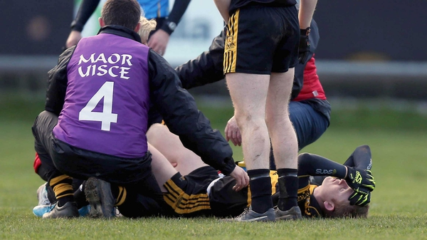 Colm Cooper lies injured on the O'Moore Park pitch in Portlaoise