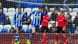 Wigan's Chris McCann (centre) celebrates after scoring the opening goal